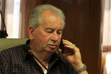 President of the Argentine Football of Association Julio Grondona speaks on the phone during a meeting in Luque, March 17, 2011. The executive committee of the South American Soccer Confederation (CONMEBOL) meet to discuss the upcoming Copa America Argentina 2011. REUTERS/Jorge Adorno (PARAGUAY - Tags: SPORT SOCCER)