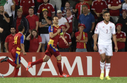 Andorra's defender Ildefons Lima (C), followed by teammate midfielder Carlos Peppe (L) celebrates after scoring a goal as Wales defender Neil Taylor looks on during the Euro 2016 qualifying round football match Andorra vs Wales on September 9, 2014 at the Municipal Stadium in Andorra. AFP PHOTO / PASCAL PAVANI