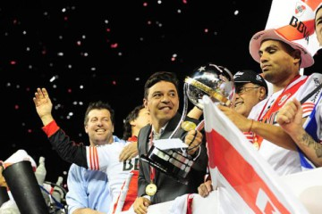 BUENOS AIRES, ARGENTINA -  DECEMBER 10: Players of River Plate celebrate with his coach, Marcelo Gallardo after winning a second leg final match between River Plate and Atletico Nacional as part of Copa Total Sudamericana 2014 at Antonio Vespucio Liberti Stadium on December 10, 2014 in Buenos Aires, Argetina. (Photo by Alfredo Herms/LatinContent/Getty Images)