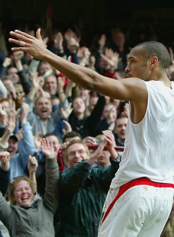 LONDON - APRIL 9:  Thierry Henry of Arsenal celebrates scoring his hat-trick and Arsenal's fourth goal during the FA Barclaycard Premiership match between Arsenal and Liverpool at Highbury on April 9, 2004 in London.  (Photo by Mark Thompson/Getty Images) *** Local Caption *** Thierry Henry