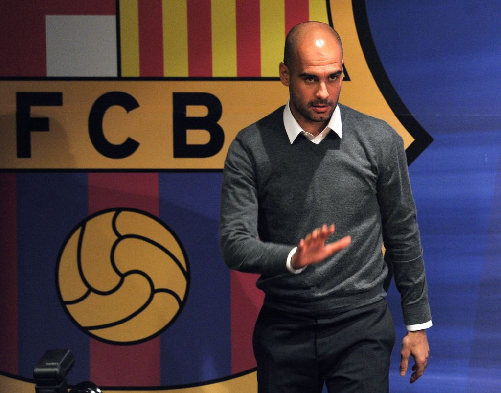 Barcelona's coach Josep Guardiola gives a press conference in Barcelona on April 27, 2012. Pep Guardiola is leaving the club, ending a four-year reign over one of the greatest eras in club football, the club president announced Today. Barcelona president Sandro Rosell made the announcement at a packed news conference in the Camp Nou alongside the 41-year-old coach. AFP PHOTO/ LLUIS GENE (Photo credit should read LLUIS GENE/AFP/GettyImages)