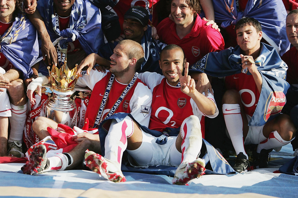 LONDON - MAY 15: Thierry Henry of Arsenal celebrates winning the Premiership during the FA Barclaycard Premiership match between Arsenal and Leicester City at Highbury on May 15, 2004 in London. (Photo by Clive Mason/Getty Images)