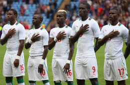 COVENTRY, ENGLAND - AUGUST 01:  Senegal players stand together during their national anthem during the Men's Football first round Group D Match between Senegal and United Arab Emirates, on Day 5 of the London 2012 Olympic Games at City of Coventry Stadium on August 1, 2012 in Coventry, England.  (Photo by Cameron Spencer/Getty Images)
