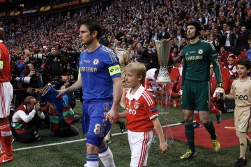 Benfica's Luisao and Chelsea's Frank Lampard  lead their teams out for the Europa League final soccer match at the Amsterdam Arena