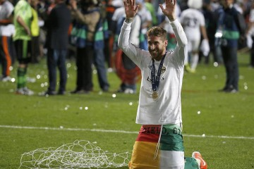 Real Madrid's Sergio Ramos celebrates after defeating Atletico Madrid in the their Champions League final soccer match at the Luz Stadium in Lisbon, May 24, 2014. REUTERS/Paul Hanna (PORTUGAL  - Tags: SOCCER SPORT)
