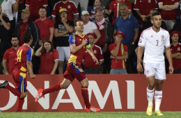 Andorra's defender Ildefons Lima (C), followed by teammate midfielder Carlos Peppe (L) celebrates after scoring a goal as Wales defender Neil Taylor looks on during the Euro 2016 qualifying round football match Andorra vs Wales on September 9, 2014 at the Municipal Stadium in Andorra. AFP PHOTO / PASCAL PAVANI        (Photo credit should read PASCAL PAVANI/AFP/Getty Images)