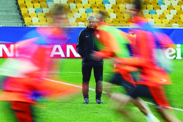 Shakhtar Donetsk's coach Lucescu attends a training session with his players at the Arena Lviv stadium in Lviv